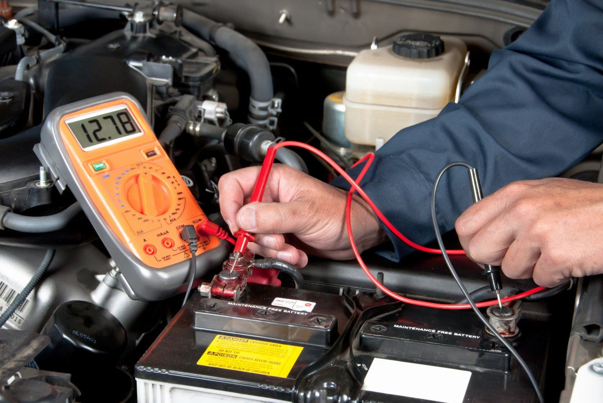 battery diagnostics being ran on a car battery by a mechanic